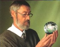 Colin Terris examines a paperweight
